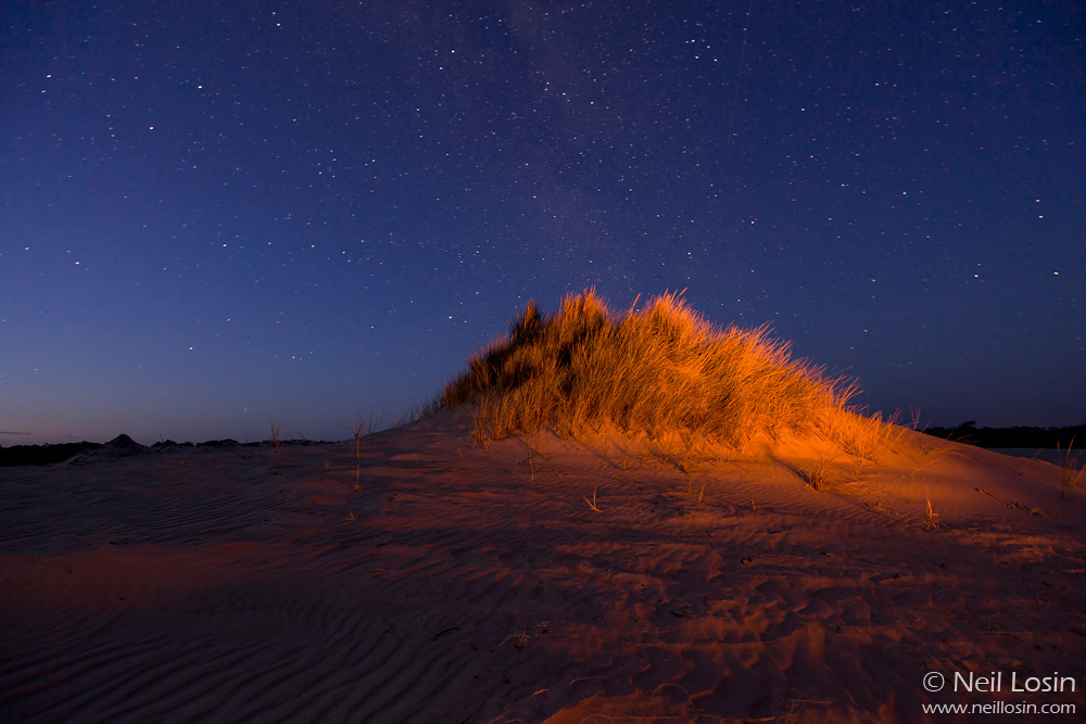 Stars and dunes by firelight at the Yeagarup Dunes, D'Entrecasteaux National Park, southwest Australia.