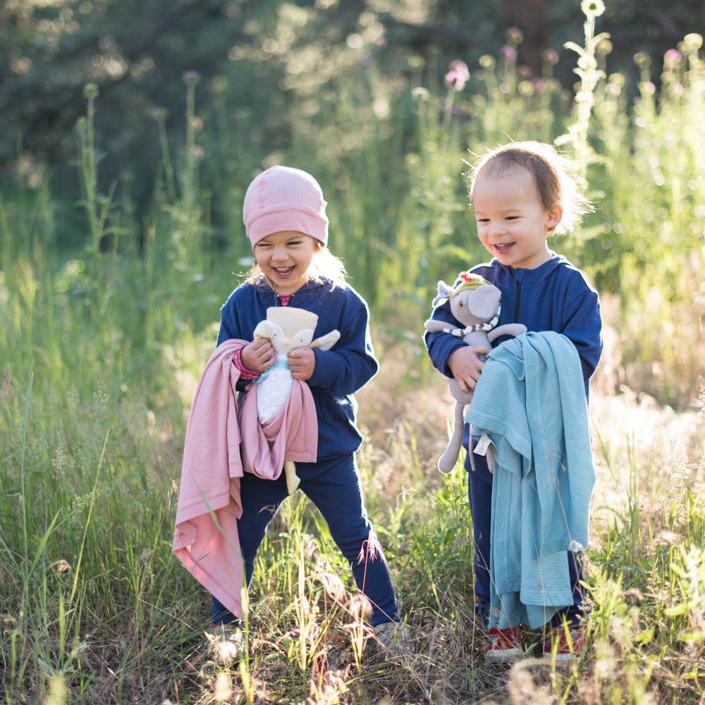 Two happy campers, holding their merino companion blankets and clutching their Hazel Village friends.  And, yes, a merino beanie is just right for sun rise in the foothills.