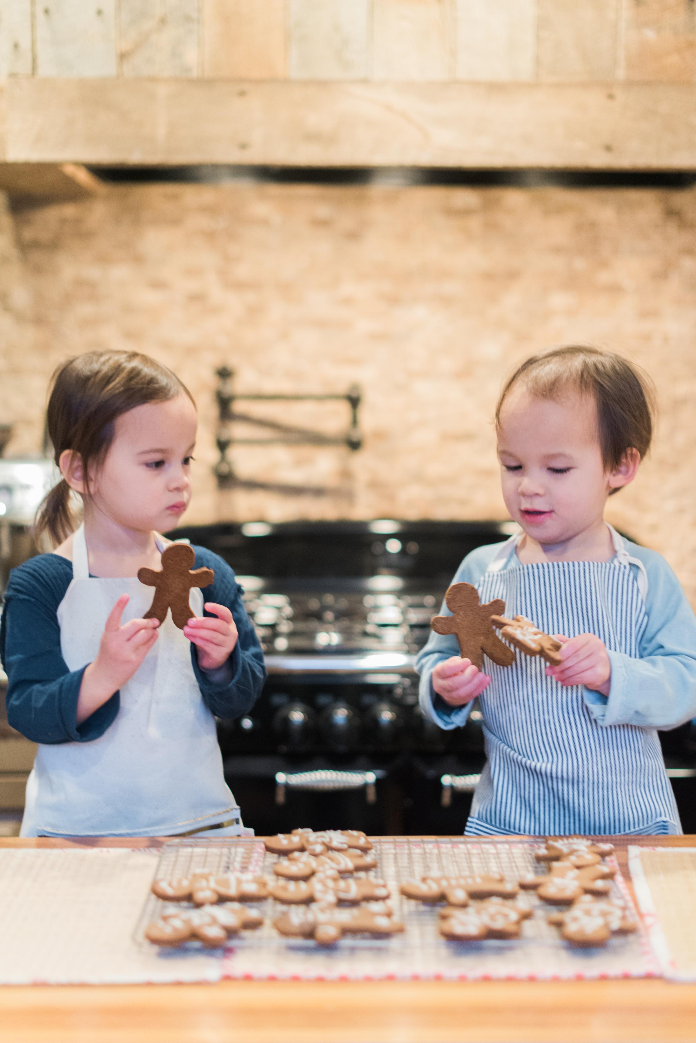 Our favorite little helpers eyeing their freshly baked gingerbread cookies!