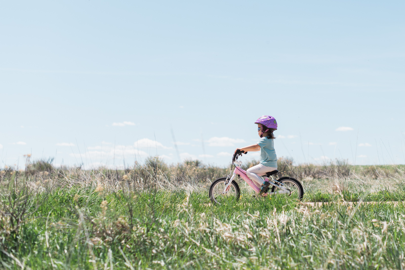 Cruising on her bike in a  Follow Rivers merino tee , our little girl is ready to chase butterflies.