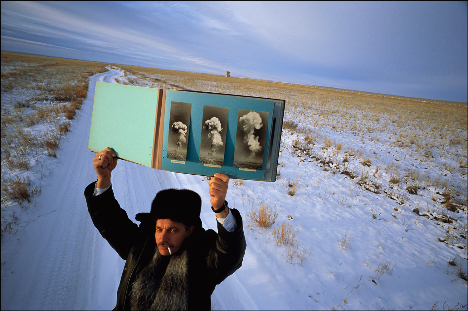 With pride, Vladimir Afonin, Security Chief, shows a book documenting Russian nuclear tests in Semipolitinsk, Kazakhstan. It is 30 degrees below zero.