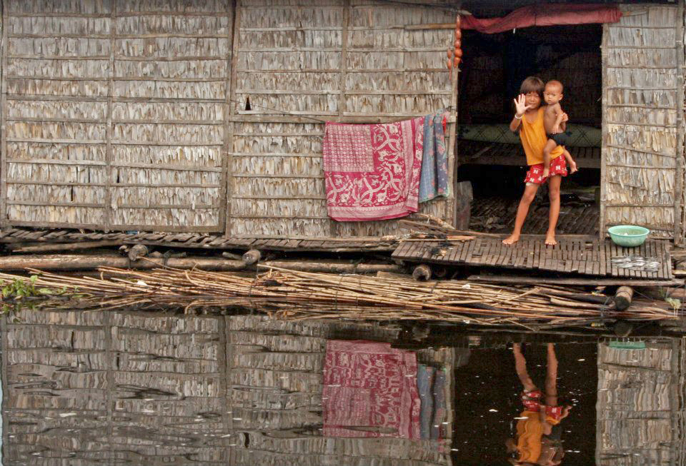 Children in a floating village of Ton Sap Lake, Cambodia