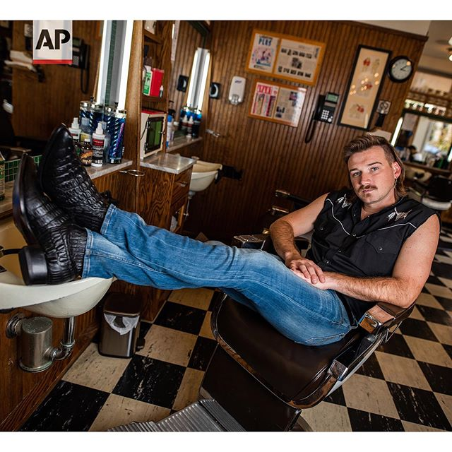 """Country singer Morgan Wallen poses for a portrait after getting a mullet at Paul Mole Barber Shop on Tuesday, Aug. 27, 2019, in New York. Wallen, who has turned heads with his likable hit song """"Whiskey Glasses,"""" said he decided to try a mullet after seeing old photos of his dad proudly rocking the hairstyle. (Photo by Charles Sykes/Invision/AP). Story by @musicmesfin"""