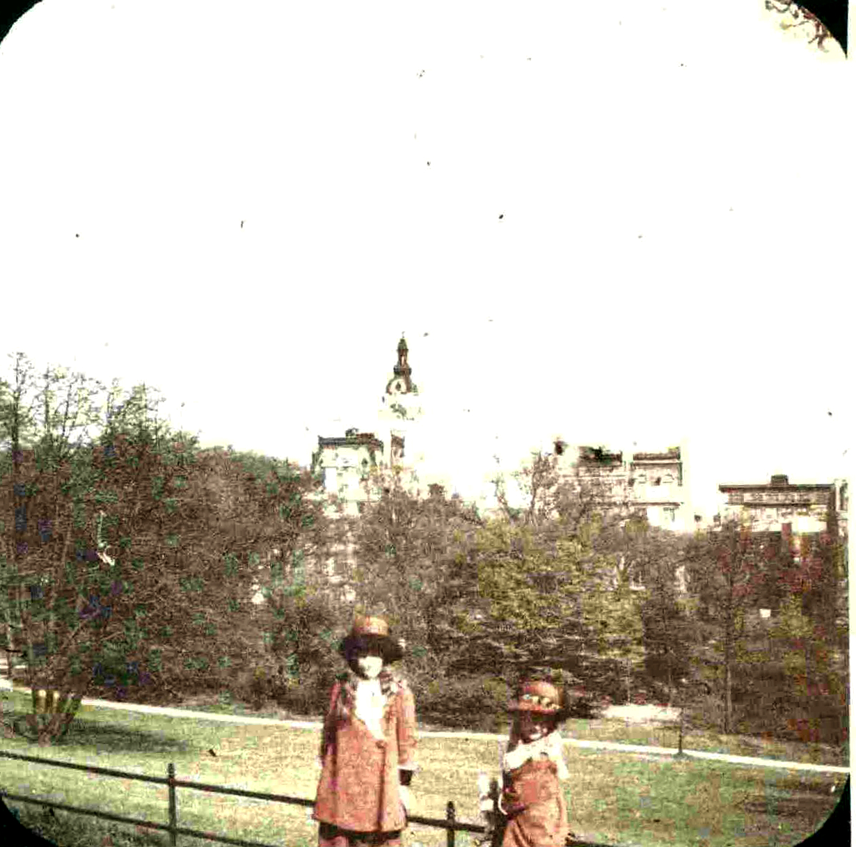 The sisters in Central Park with the Clark mansion tower in background.