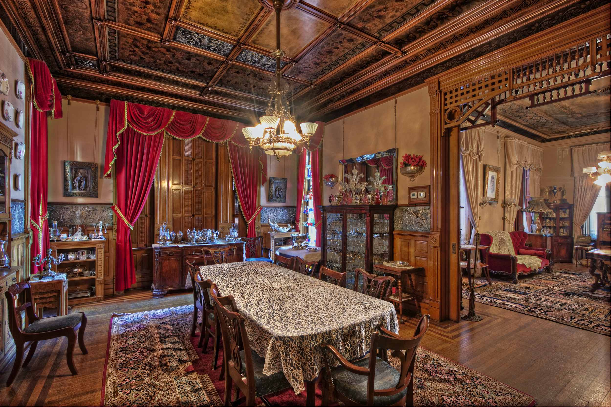 Dining room, Copper King Mansion, the W.A. Clark home in Butte, Montana. From the dining room, floor-to-ceiling windows led to a wraparound porch, allowing the men to step out to smoke cigars while discussing business and politics.c. Daniel Hagerman. Prints for sale at http://fineartamerica.com/art/all/copper+king+mansion/all.