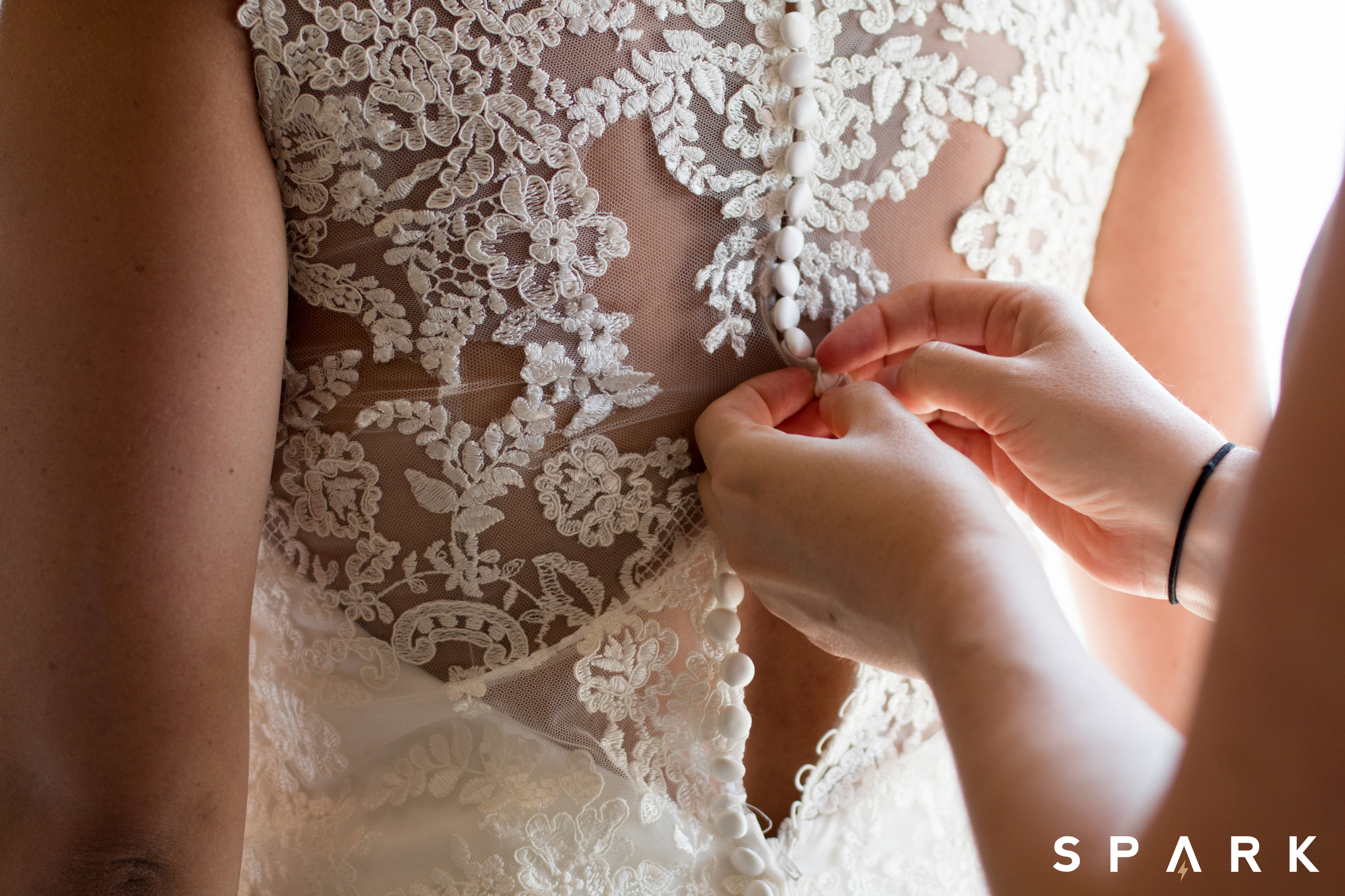Pictured Above : Kelli's beautiful lace gown was found at  Michelle's Bridal Shoppe  in Champagne, Illinois.