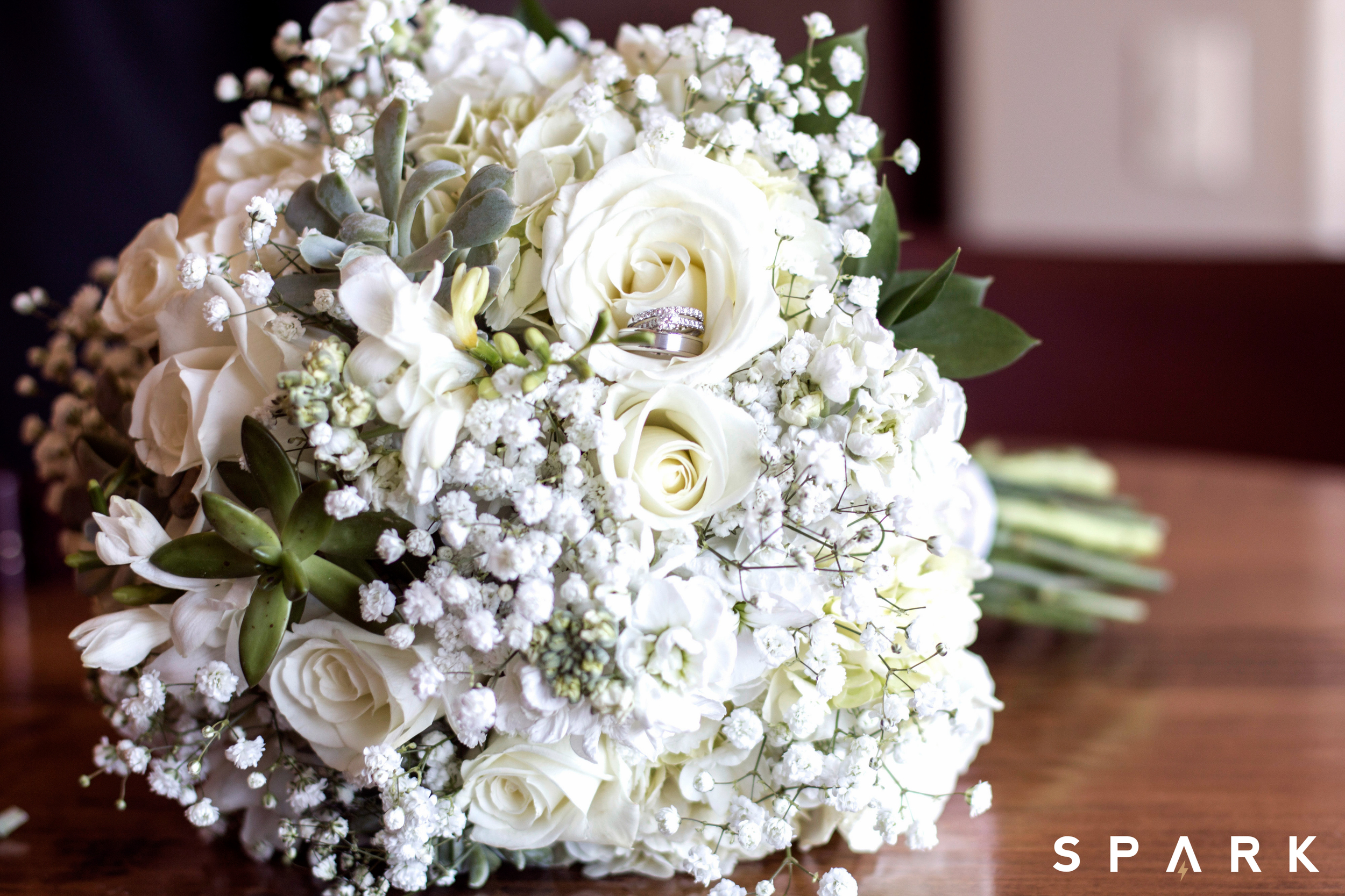 Pictured Above : Kelli's bouquet arrangement consisted of white roses, hydrangeas, baby's breath, and succulent accents.