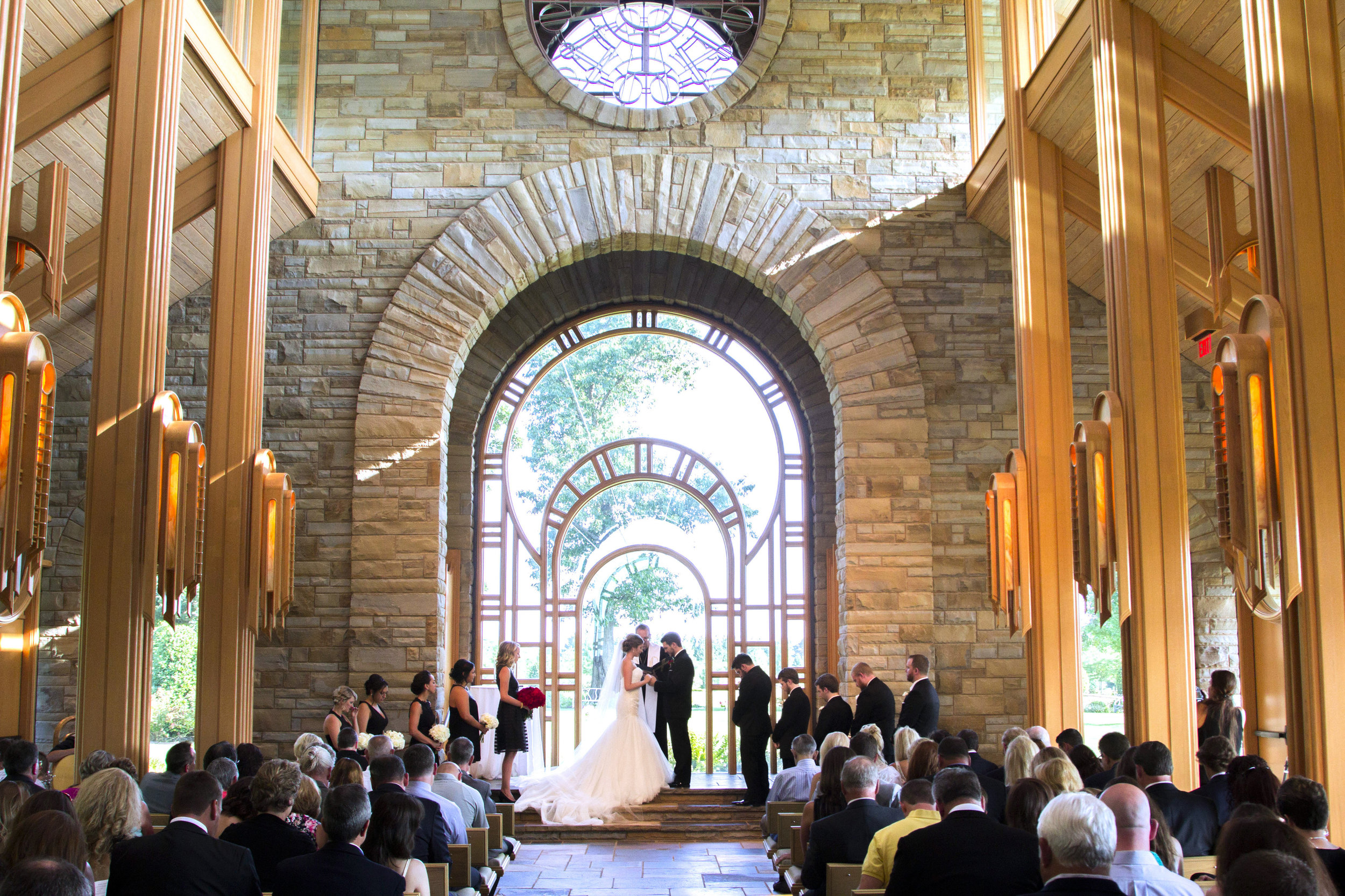 ABOVE: Ashley & Brian held their ceremony at the  Hunt Chapel  in Rogers, AR.