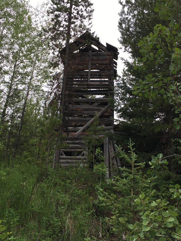 Water tower at the Kintla Ranch. In 1947, Matt Brill sold the Kintla Ranch to the Wilson family. Larry Wilson remembers hauling water from the tower and firewood to each guest cabin each morning.
