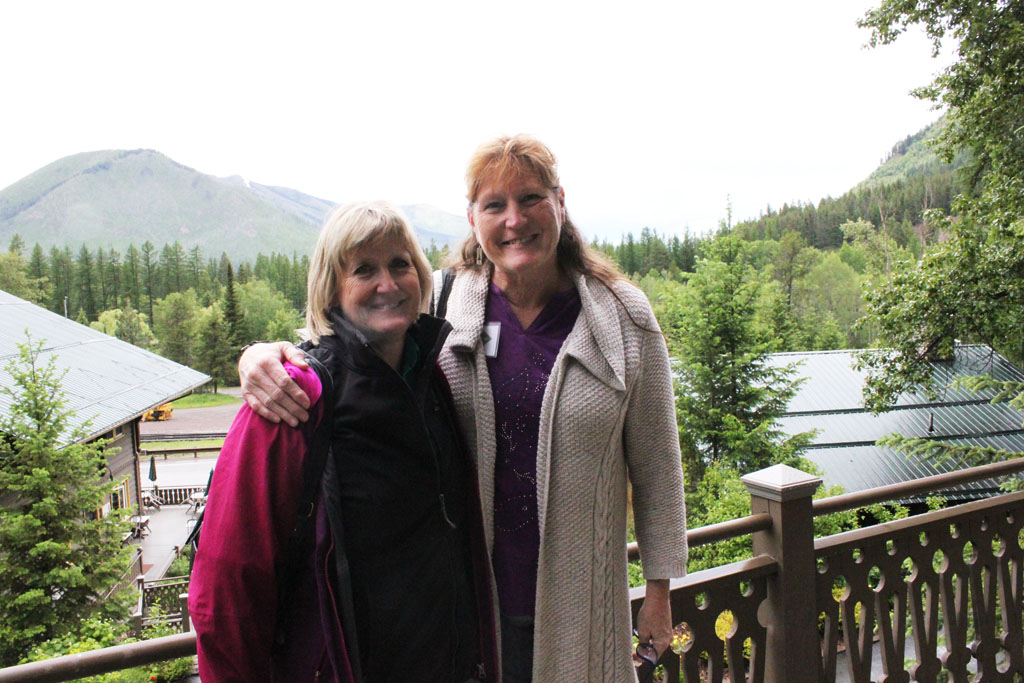 Enjoying the view at Belton. Charlene Porsild of the Montana History Foundation and Deb Mitchell of the Montana Historical Society on the balcony at Belton Chalet.