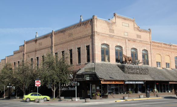 John McIntosh built Opera House Square in 1896 in bustling downtown Kalispell. The building to the north housing Norm's News was added in 1903.