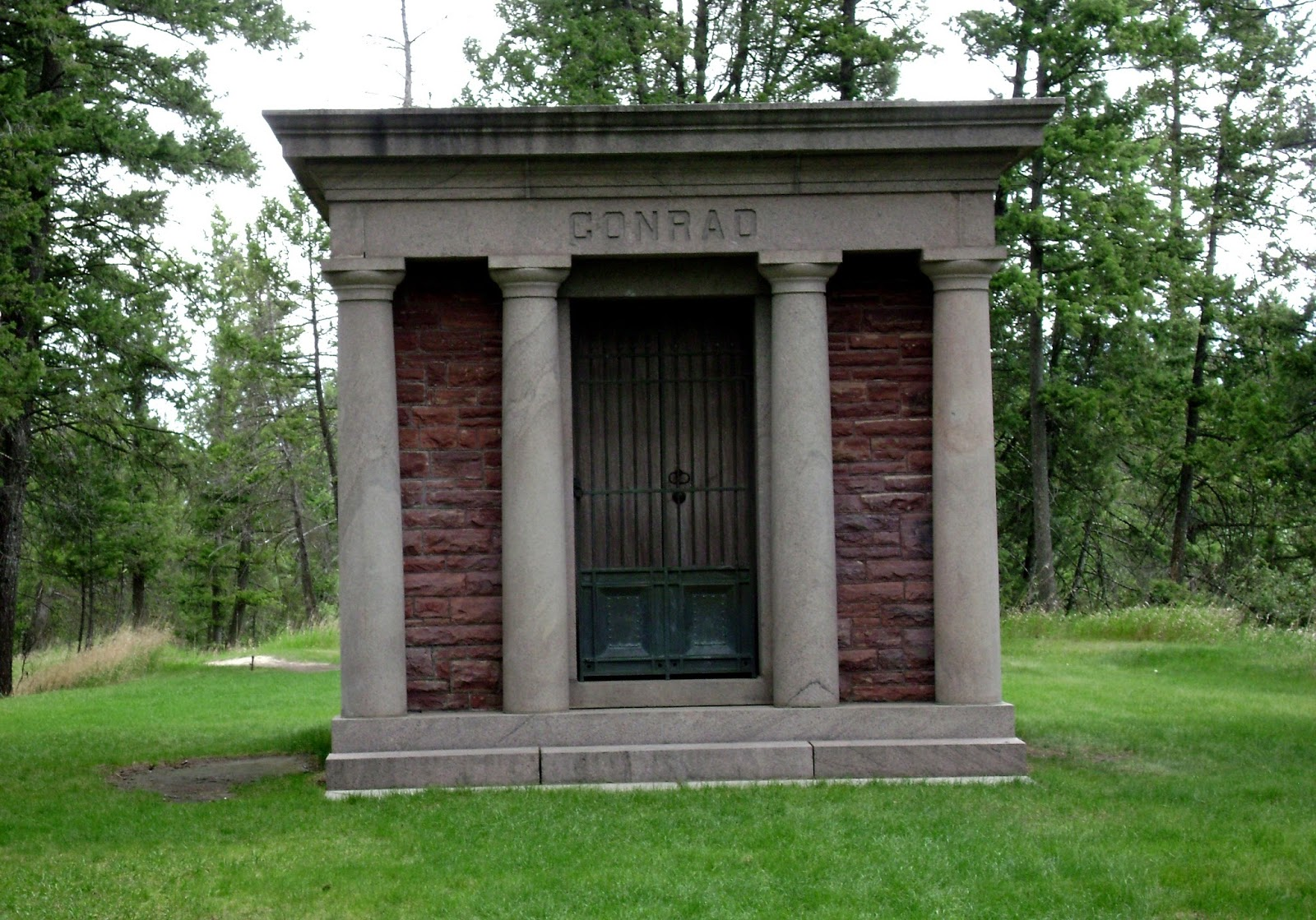 Although our bus couldn't navigate through Conrad Cemetery, we were lucky to drive in part way and hear from Montana Historical Society Interpretive Historian, Ellen Baumler about Charles Conrad's last resting place — a beautiful, lush, and expansive designed landscape on the east side of Kalispell along the Flathead River.