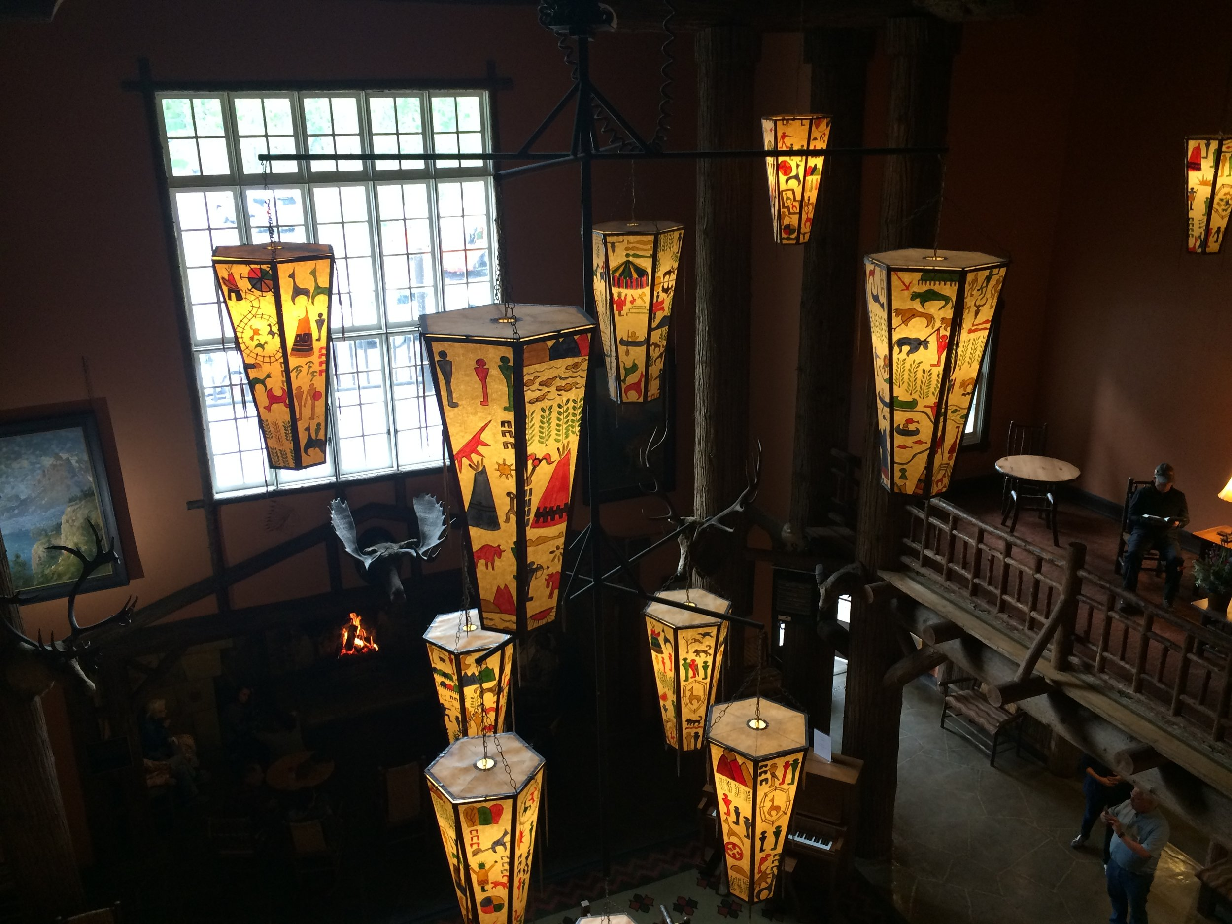 Inside the Lake McDonald Lodge lobby, the hanging lanterns are reproductions of original work made by Kanai craftsmen for the Prince of Wales Hotel in Waterton Lakes National Park, Canada, which had been moved to Lake McDonald in the 1960s.