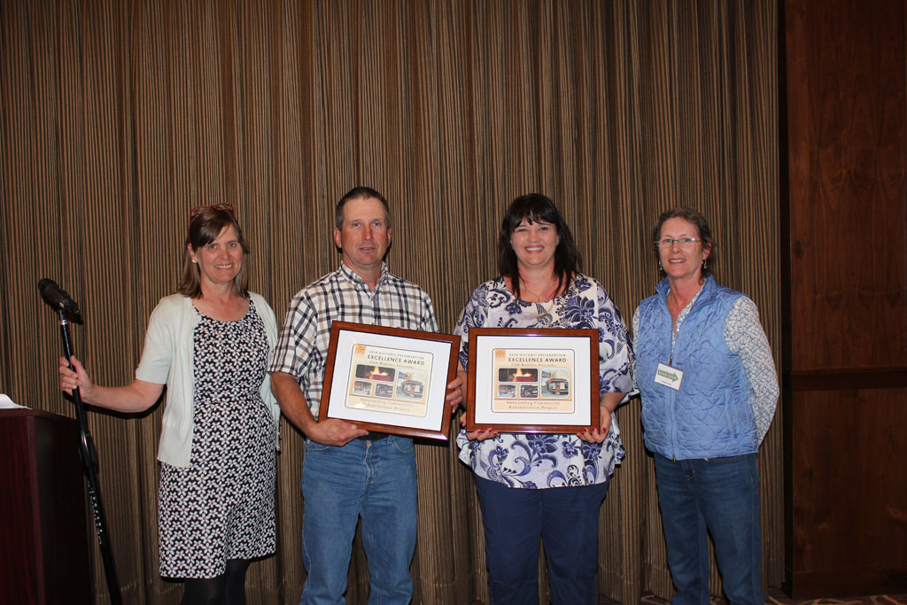 John & Stephanie Hekkel accepting the Outstanding Commercial Restoration Award for their work on the Club Moderne alongside Chere Jiusto (left) and Stephanie Ambrose-Tubbs (right).