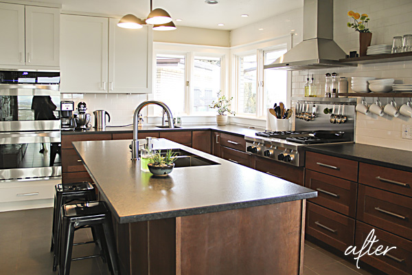 The kitchen cabinetry features the same quarter-sawn oak and painted white cabinets but in a shaker door style.