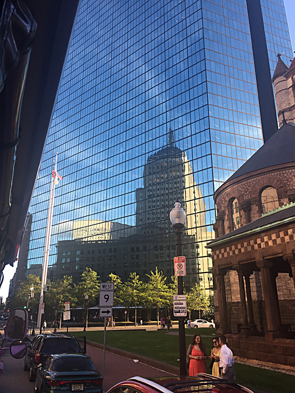 The old John Hancock Building reflected in the new John Hancock Building.