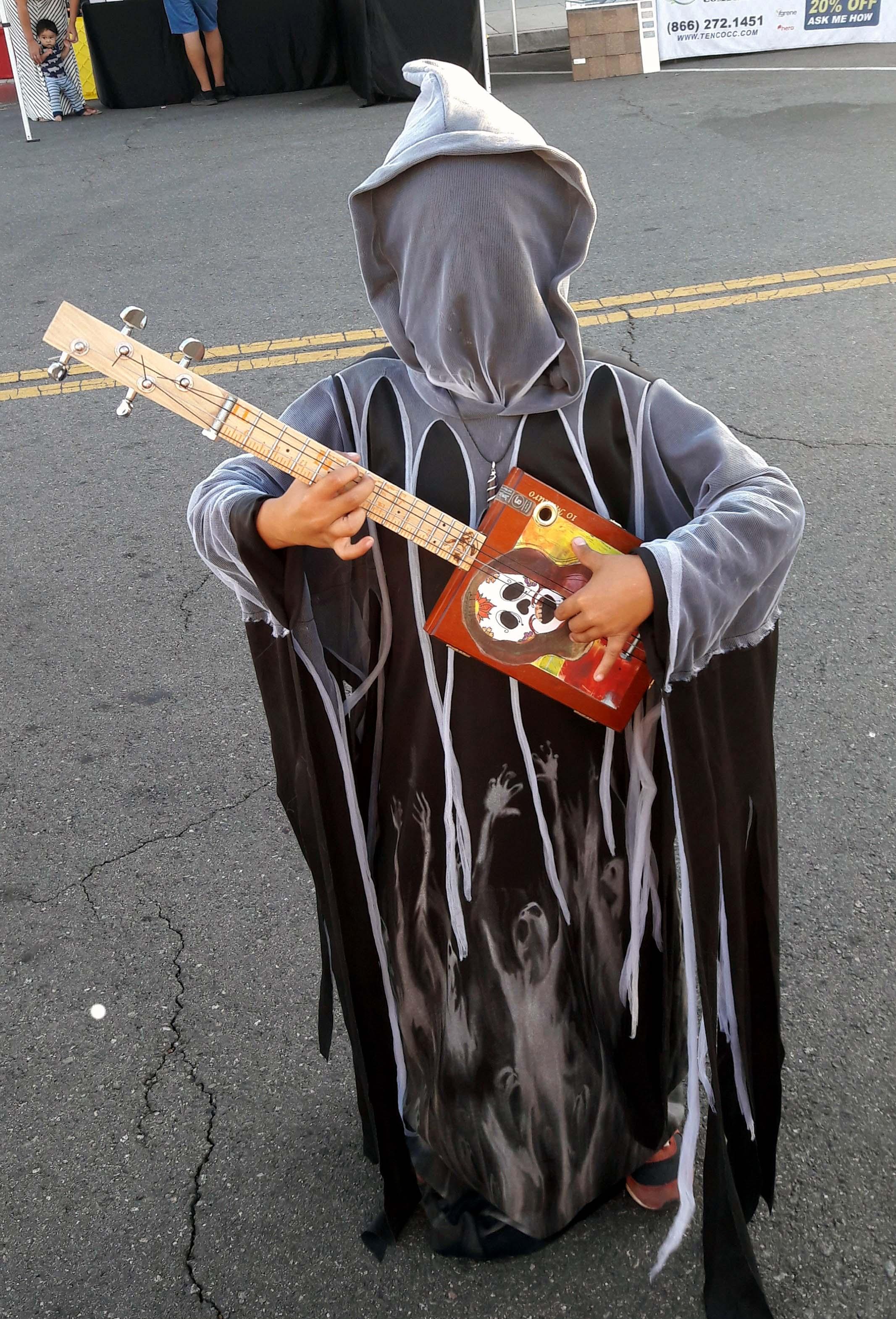 Death plays a ukulele.jpg