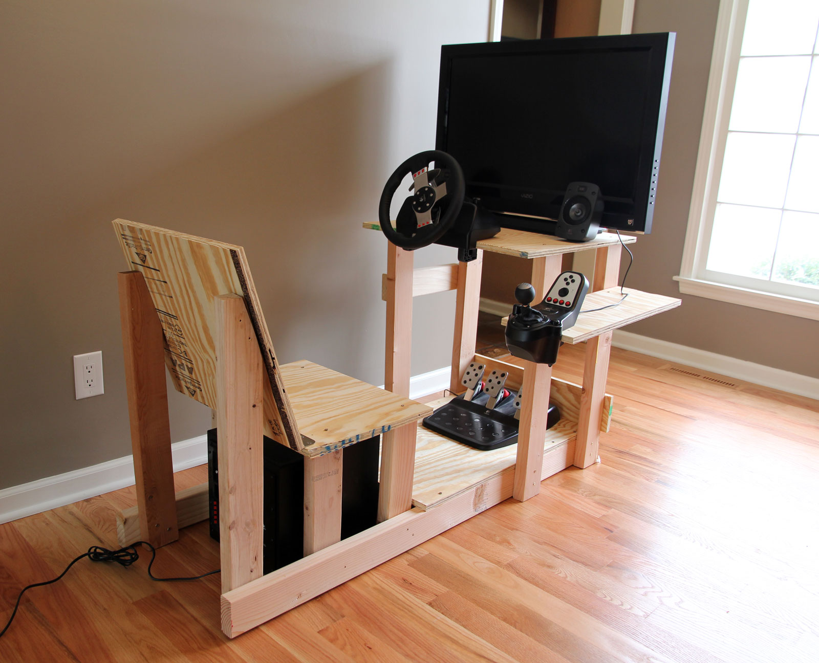 Unpainted chair with plywood seat and gaming hardware