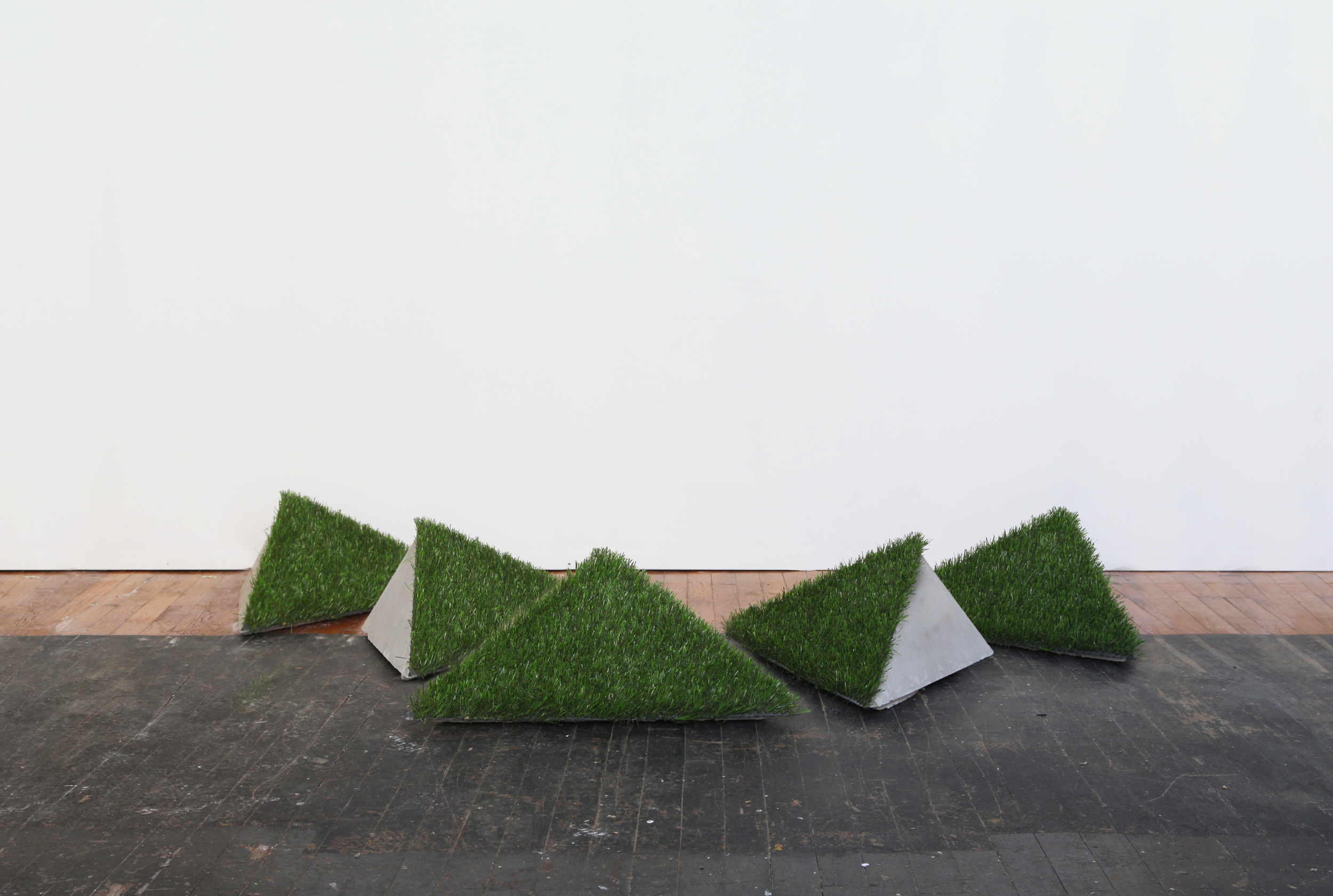 The Grass is Greener, 2012 astroturf, plaster, 63 x 38 x 17 in