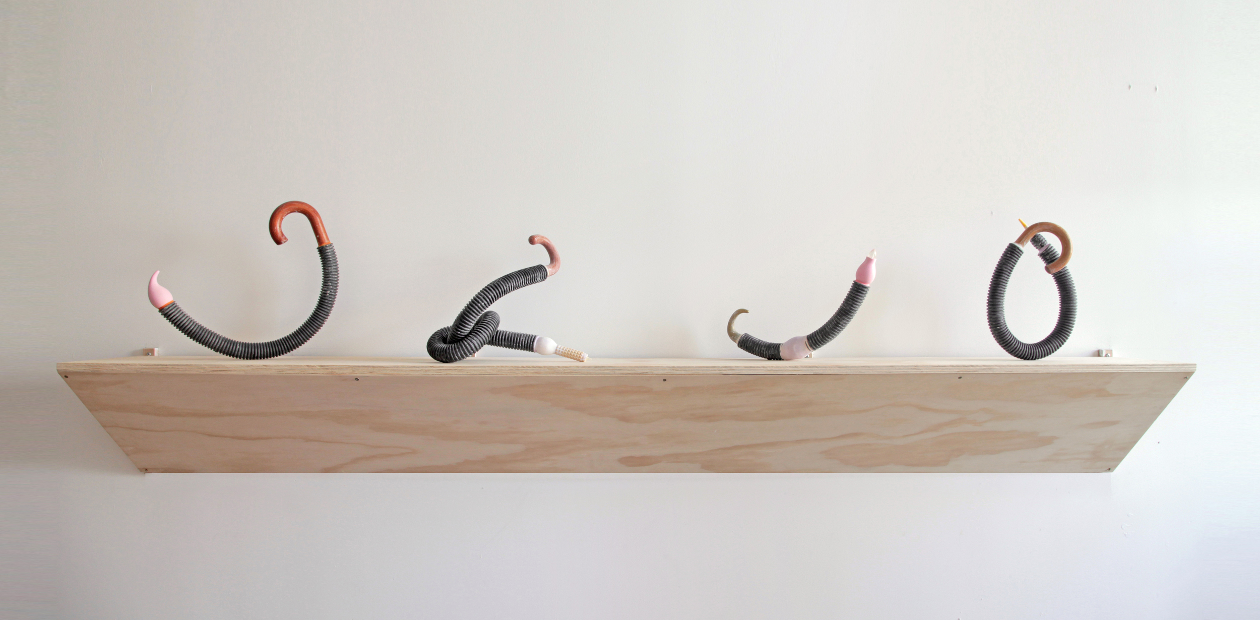 The Ends of Things (installation view), 2014 umbrella handles, hose, plaster, pigment, found objects 16 x 96 x 12 in