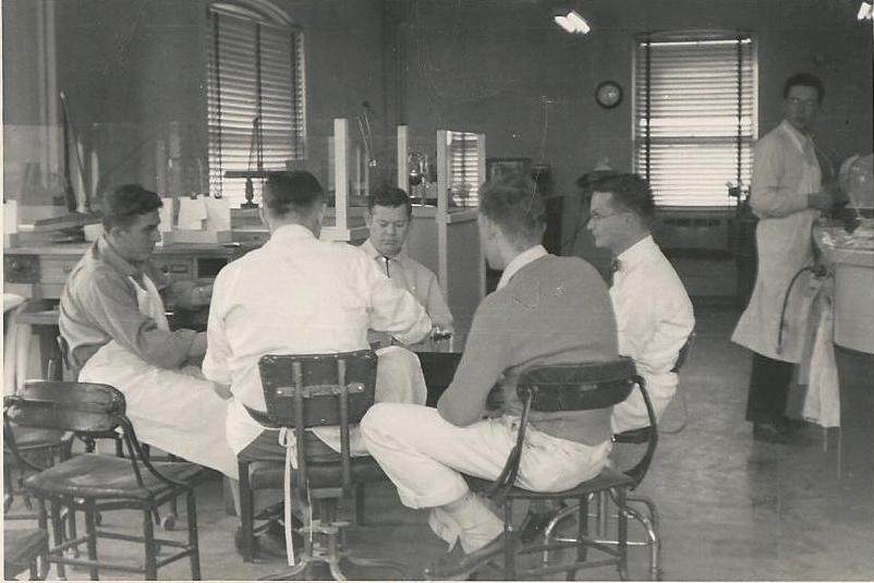 Robert Renstrom is on the far left. We aren't exactly sure when or where the photo was taken, but it is at one of the first labs Bob worked at, and appears that they are taking a little break, or possibly discussing some work that needs to be done.