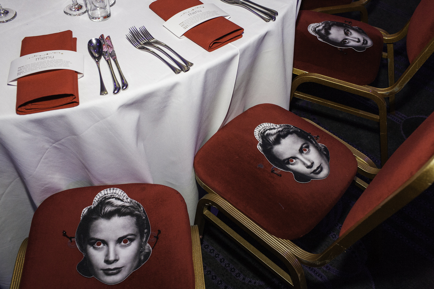 Different famous actors and actresses were on each table as masks.