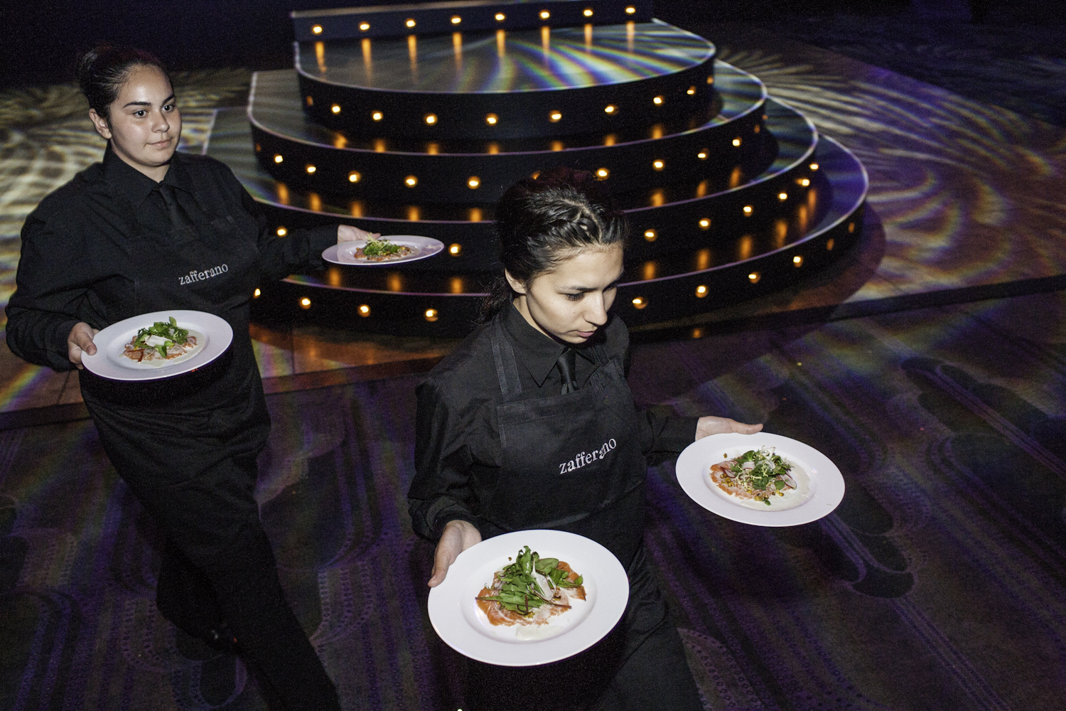 Waiters serve delicious food at the Troxy