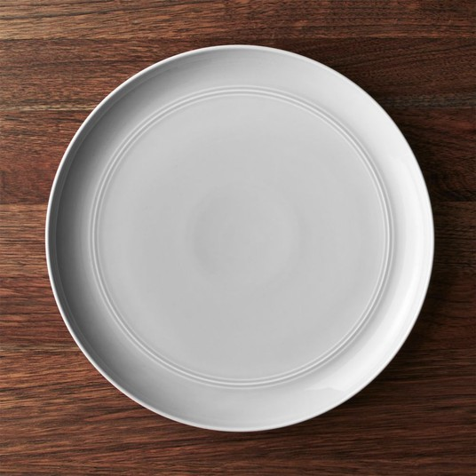 """Grey Serving Plate // $20   Grey is a trendy neutral so it works en lieu of a traditional """"white plate"""" pretty to stack on a table and effortlessly chic."""