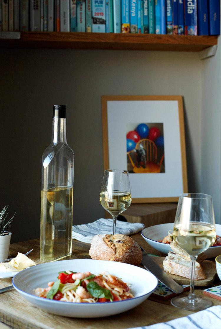 white wine bottle glasses and food.jpg