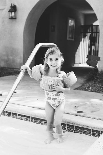Natalie learning to swim again.