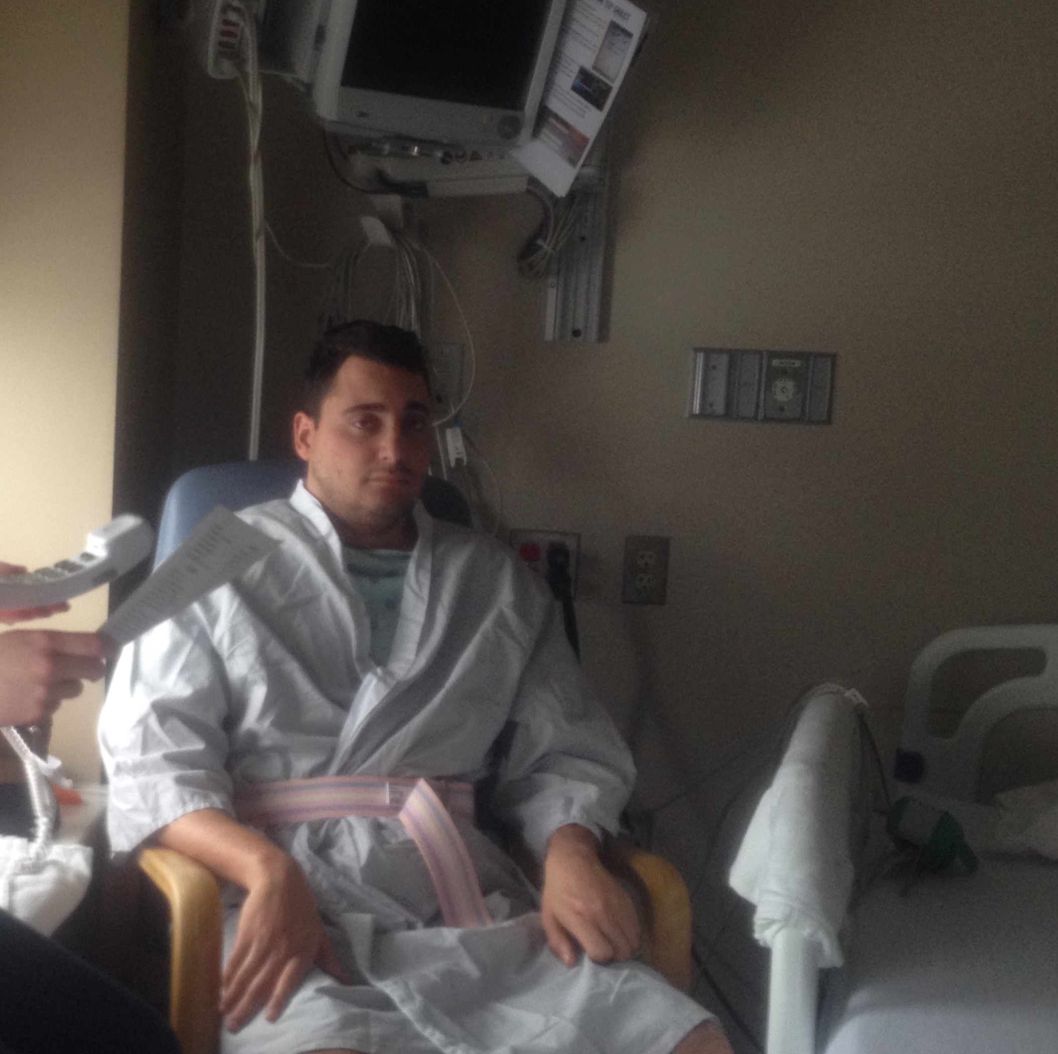 March 2015, days after my injury in the neuro-ICU, sitting up for the first time post-injury.