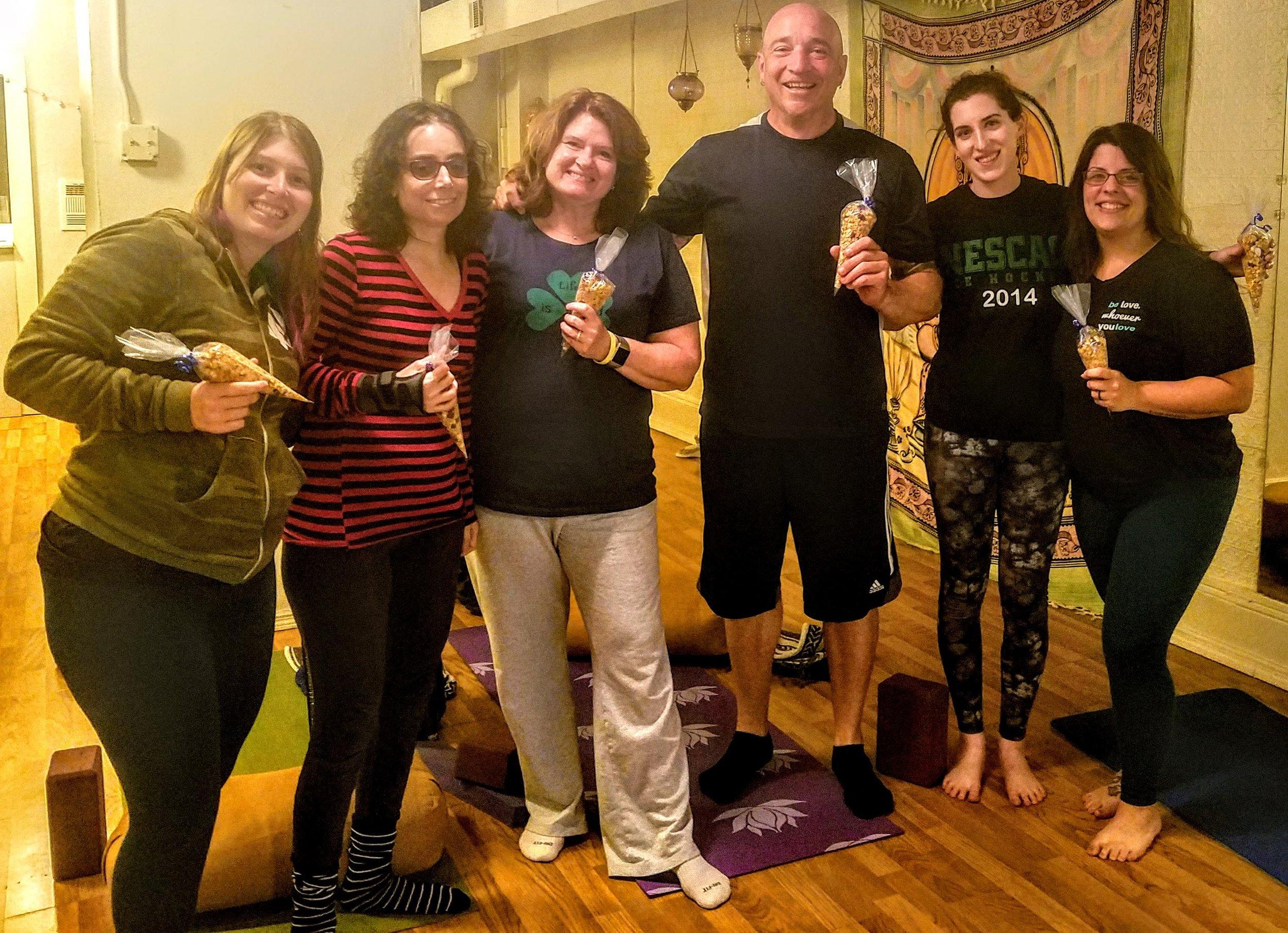 Holding crunchy granola on the last day of LYB Yoga