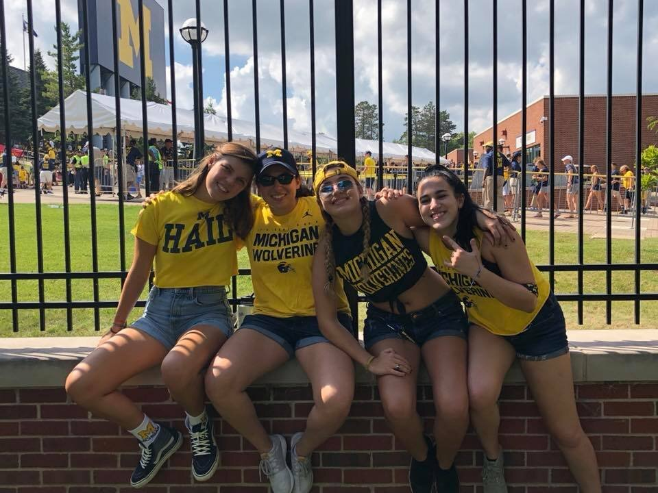 Outside the Big House on game day at Michigan rocking some special green tinted glasses with some of my best friends on campus.