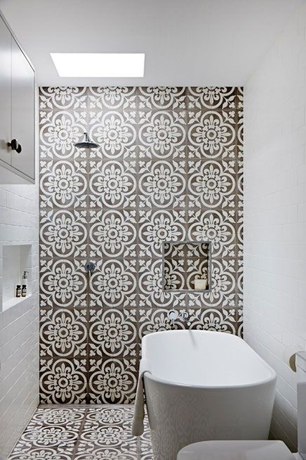 I love how the tile wraps up the wall from the floor - very striking in contrast to the white subway tiles.