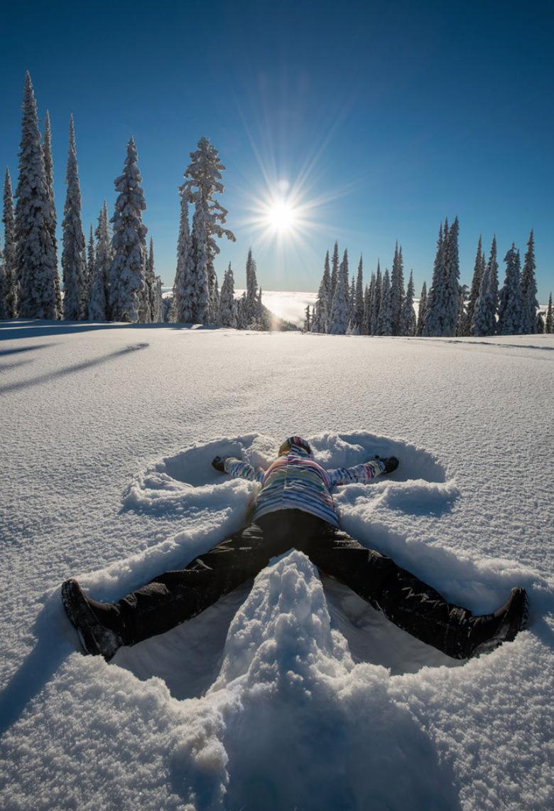 Making a snow angel in freshly fallen snow : )