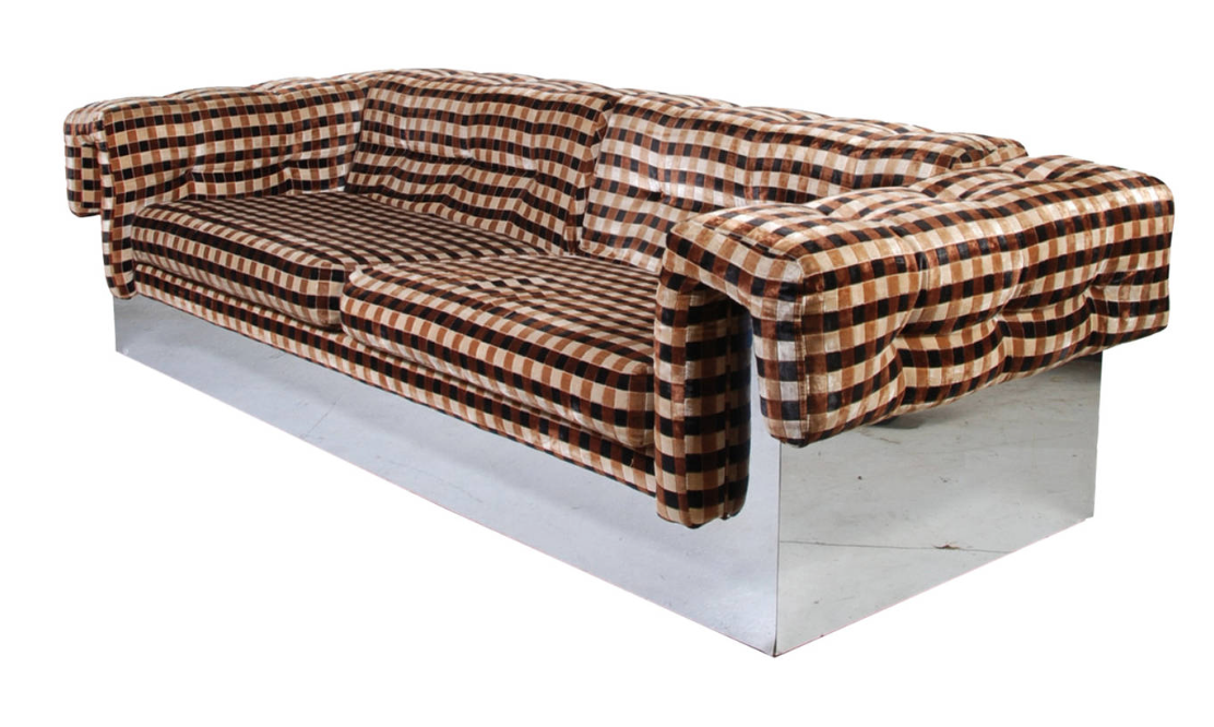 This sofa literally looks like it's floating in a room.  Love the original 70's fabric ; )