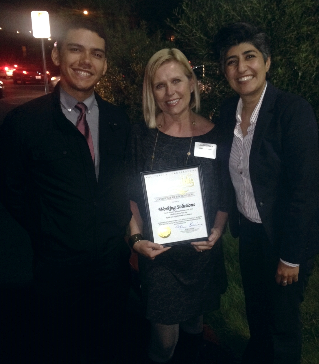 ROberto Hernandez, Laurie O'Hara and Sara Razavi of Working Solutions were thrilled to receive the award on behalf of Working Solutions' staff and Board of Directors