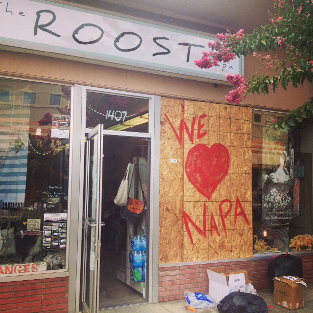 The boarded-up window of The Roost in Downtown Napa after the August 2014  earthquake