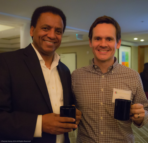 Working Solutions client Taddesse Haile of Oasis Cafe and Adam Maxfield of Williams-Sonoma