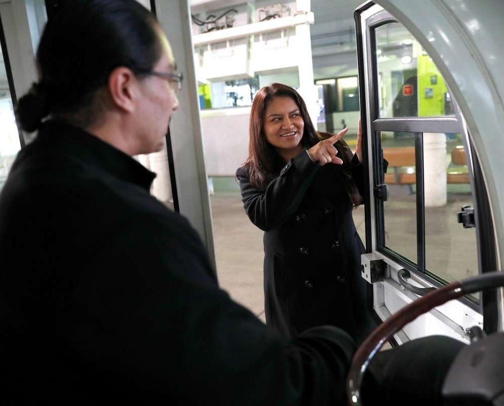 PATTY RODRIGUEZ, FOUNDER OF SF PARKING, CHATS WITH CONCIERGE GILBERT GALLEGOS AT SAN FRANCISCO INTERNATIONAL AIRPORT (PHOTO BY SCOTT STRAZZANTE/SF CHRONICLE)