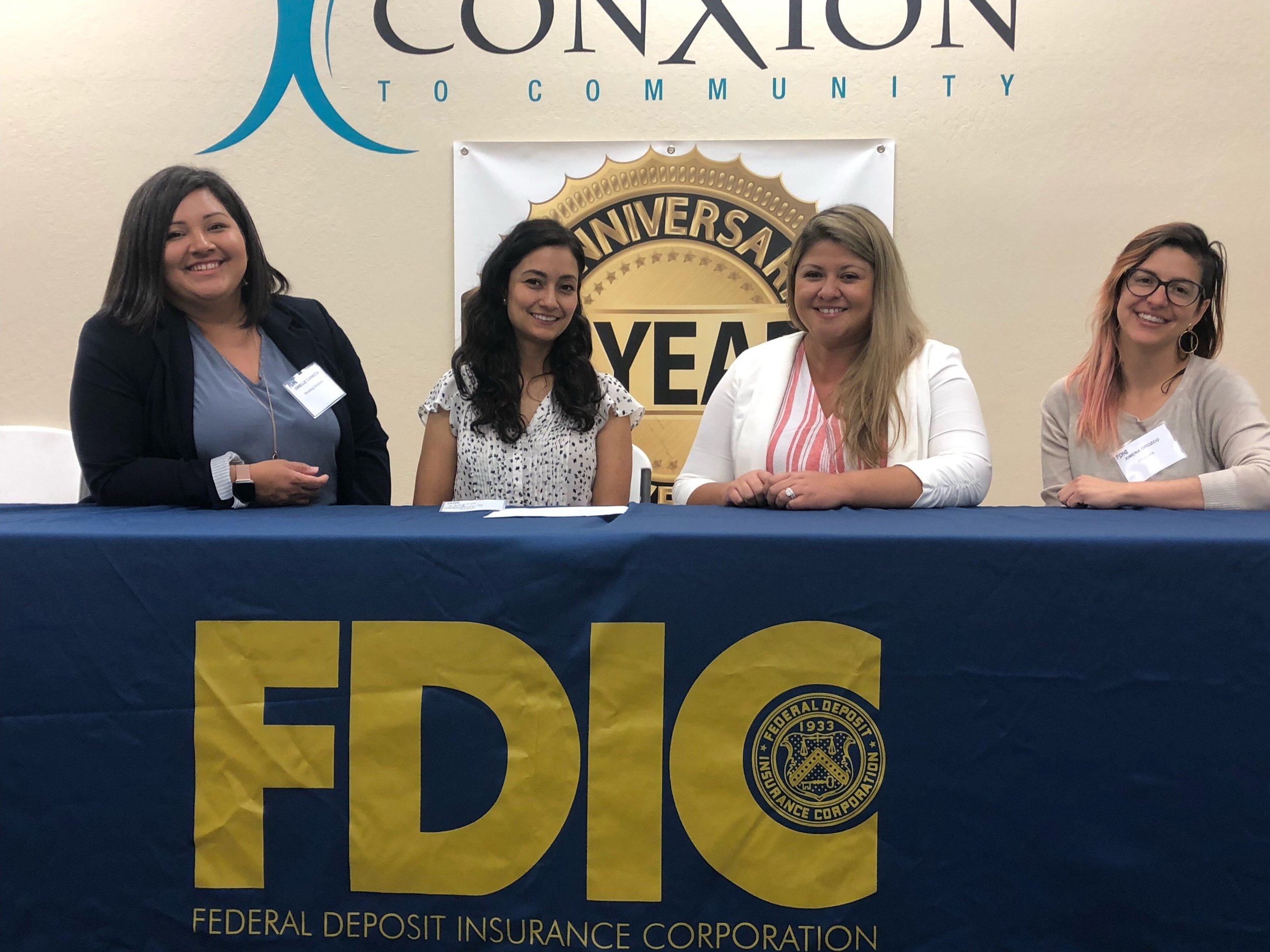 Working Solutions staff member Ginelle Curincita (far left) serving on a panel at a Spanish-language Access to Capital forum in San Jose.