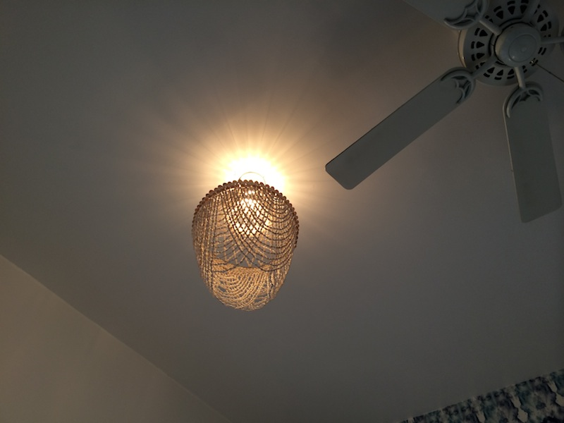 The shell chandelier goes up in the bedroom!