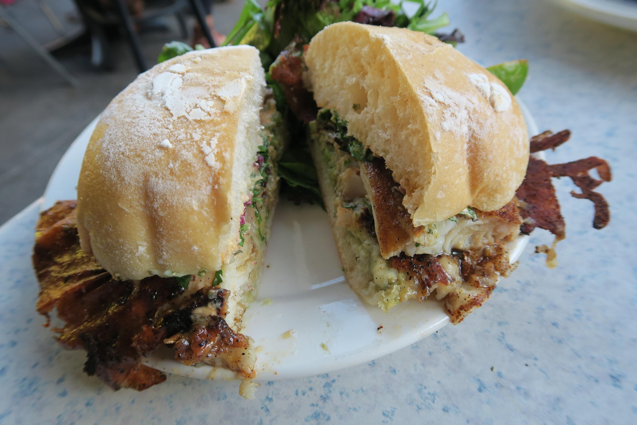 Chipotle Fish Sandwich: Seared Tilapia, Monterey Jack Cheese, Guacamole, Shredded Greens, Chipotle Aioli $12