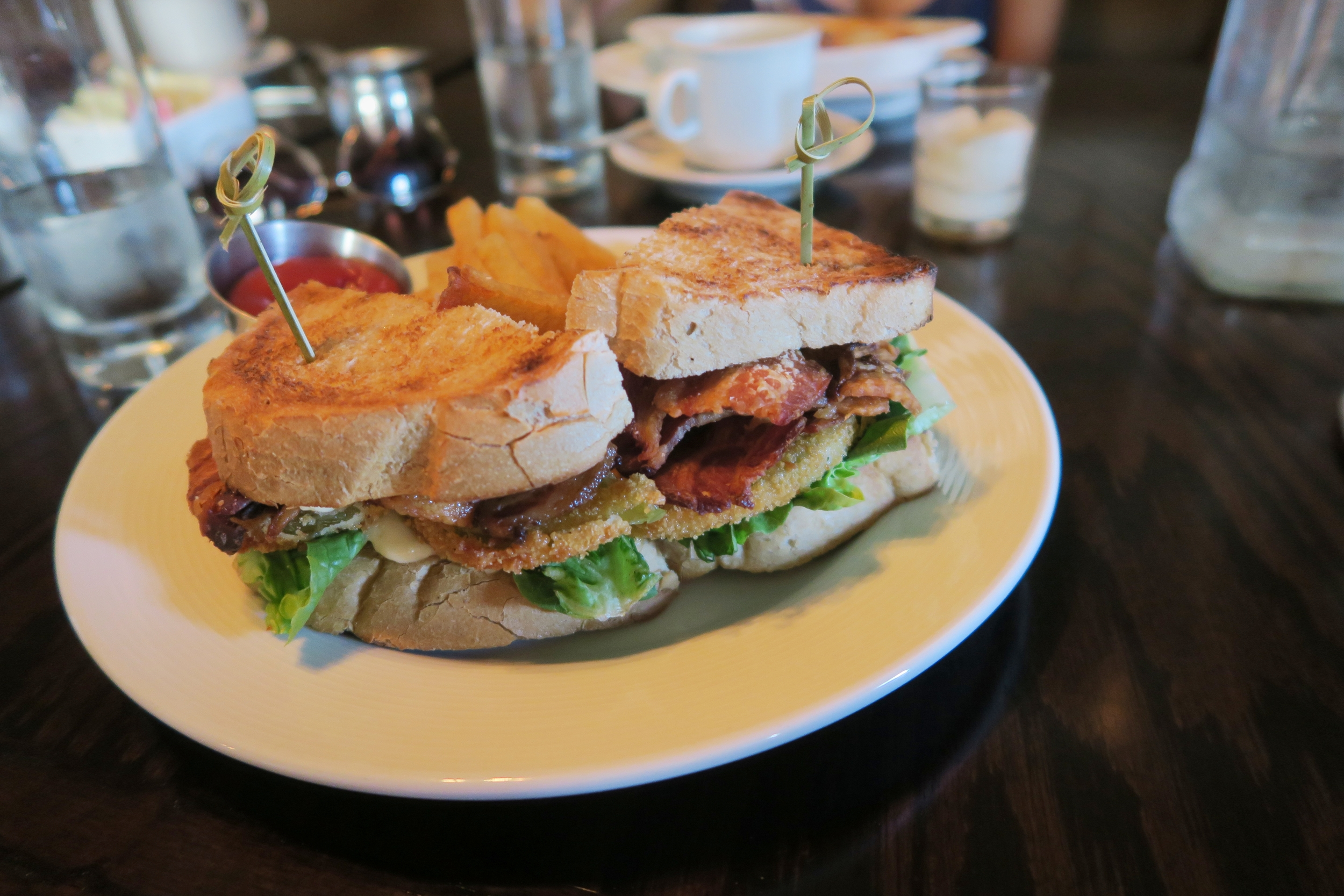 The Cub Room BLT: McCann's Bacon, Lettuce, Mayo, and Fried Greed Tomatoes with French Fries $12