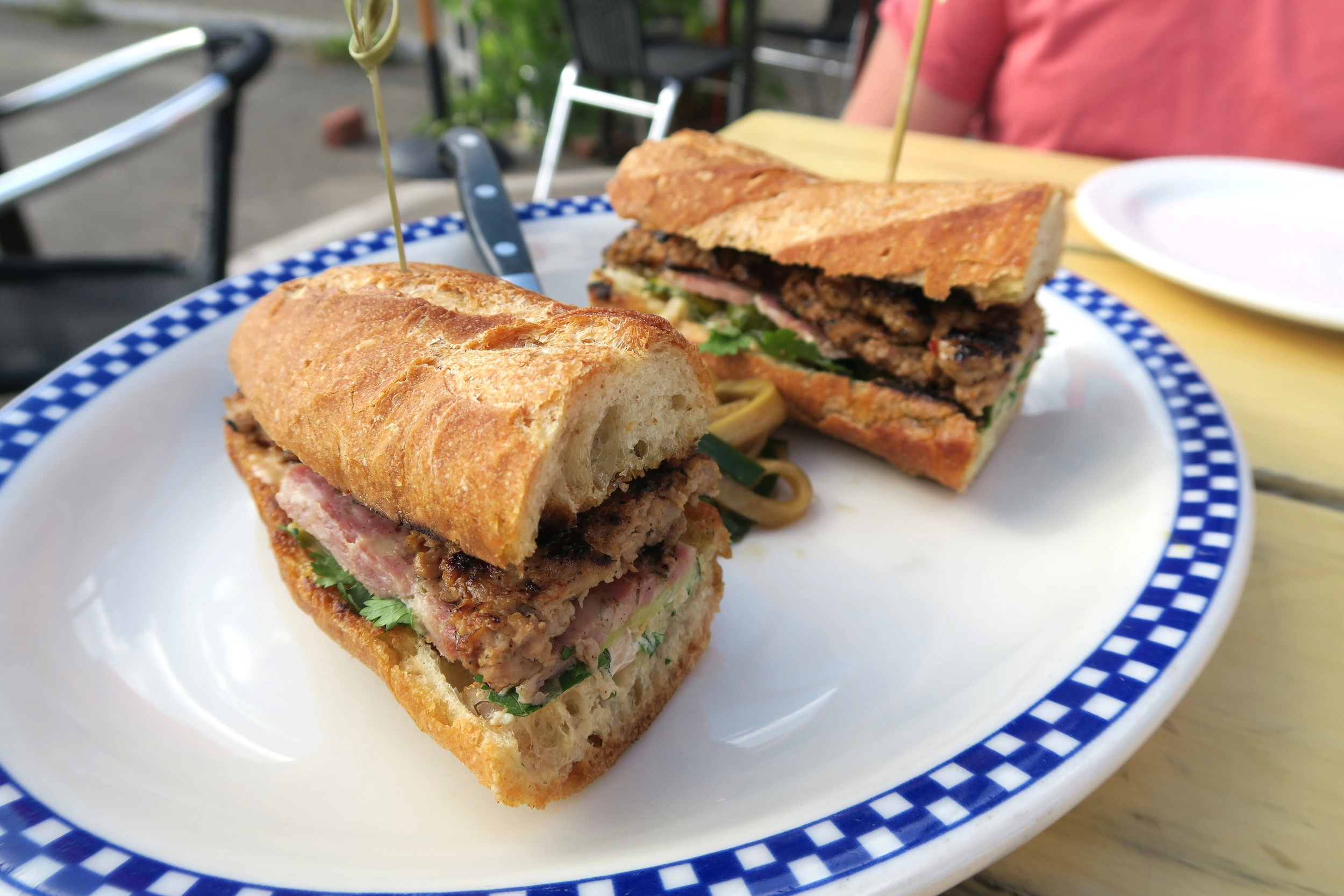 Cure's Banh Mi is served on a toasted baguette from Flour City and made with pork sausage, pate, pickled vegetables, a house made spice mayo, with a cucumber salad $16