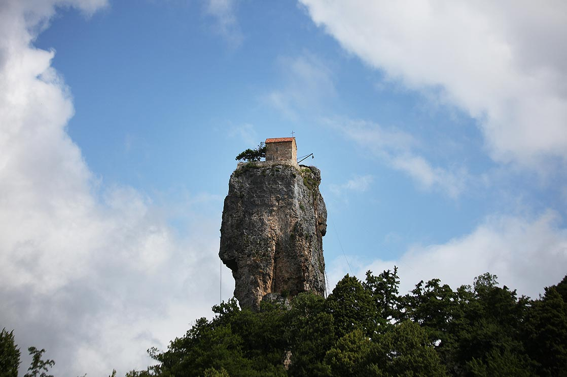 The Katskhi pillar is a naturallimestonemonolithlocated near the town ofChiatura. It is approximately 40 meters.The rock, with visible church ruins on its top surface, has been venerated by locals as the Pillar of Life, symbolizing theTrue Cross. The churchdating from the 9th or 10th century| GEORGIA