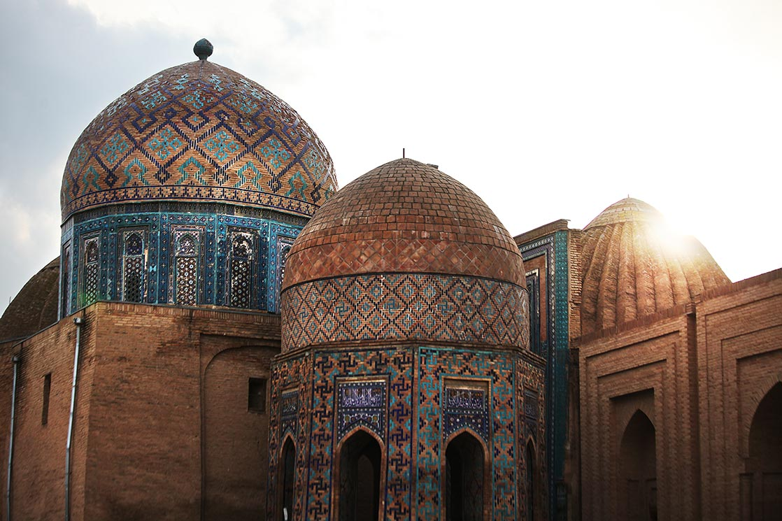 "Shah-i-Zinda   (meaning ""The living king"")  is a necropolis of  Samarkand .  The name is connected with the legend that Kusam ibn Abbas, the cousin of the prophet Muhammad was buried there.   As if he came to Samarkand with the Arab invasion in the 7th century to preach Islam  