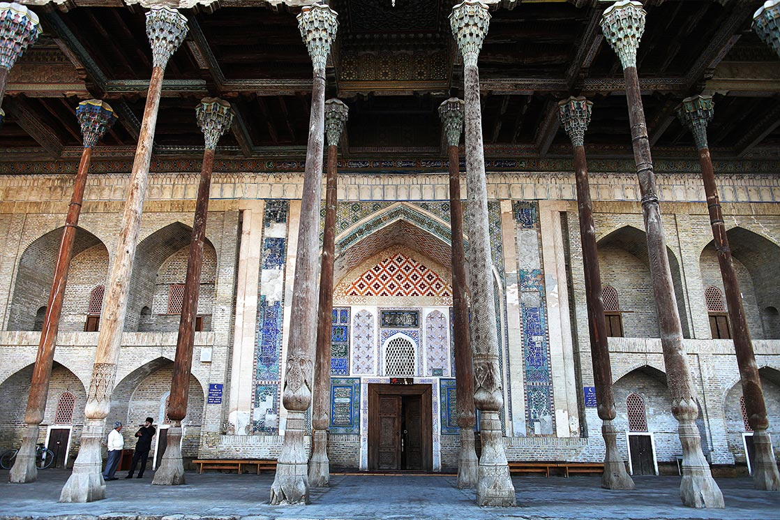 Bala Havuz mosque  (1712)  is noted for the profuse colors and carvings on the wooden columns of its porch and its ceiling. The joinery of its painted ceiling features extraordinary craftsmanship with the use of suspended weights, semi-circular arches and balusters   | UZBEKISTAN
