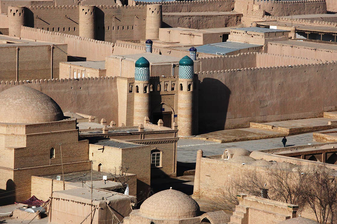 Khiva  is a city located in Chorezm Province. According to archaeological data, the city was established in the beginning of the current era.  Itchan Kala  is encircled by brick walls, whose foundations are believed to have been laid in the 10th century. Present-day crenellated walls date back to the late 17th century and attain the height of 10 meters | UZBEKISTAN