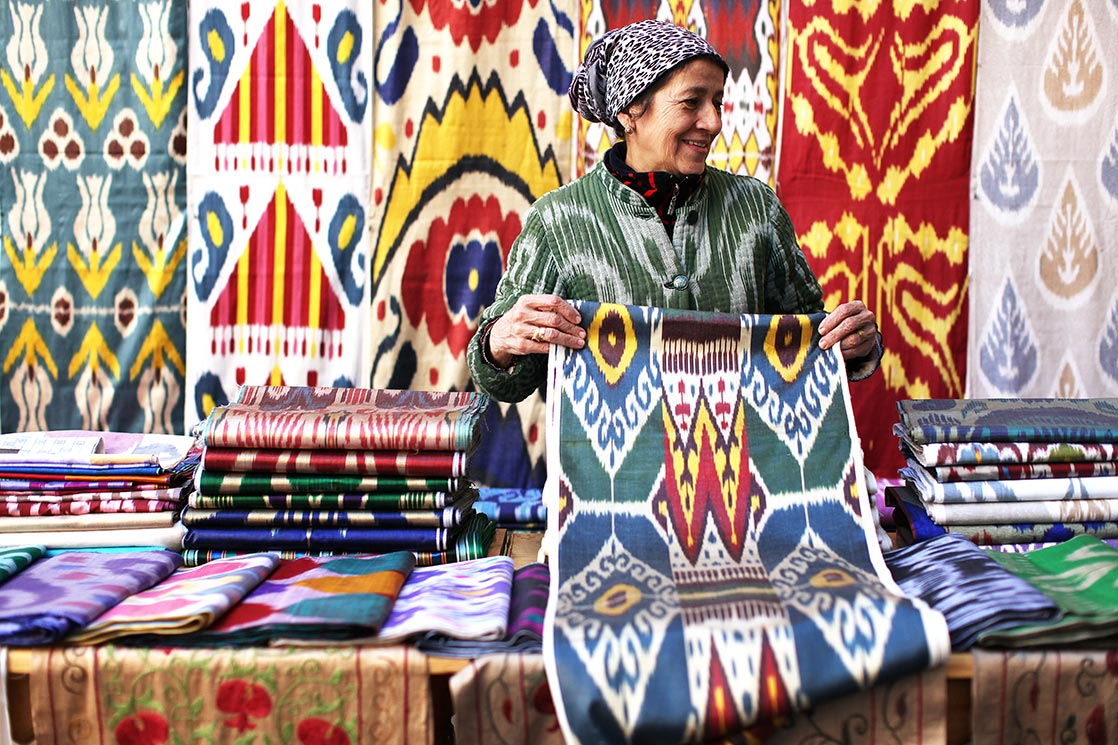 A woman who sells silk fabric in the streets of  Bukhara   | UZBEKISTAN